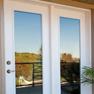 exterior deck view of white vinyl single terrace door with matching fixed door