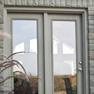 exterior deck view of sage stained vinyl terrace door with matching fixed door