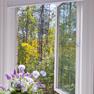 interior bathroom view of open white casement windows